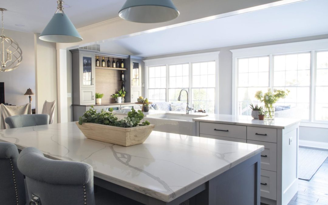 A gorgeous kitchen island made of quartz with strong veining.