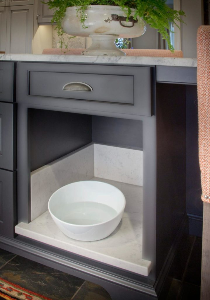 Pet dishes can be easily tucked away under cabinets or a kitchen island.