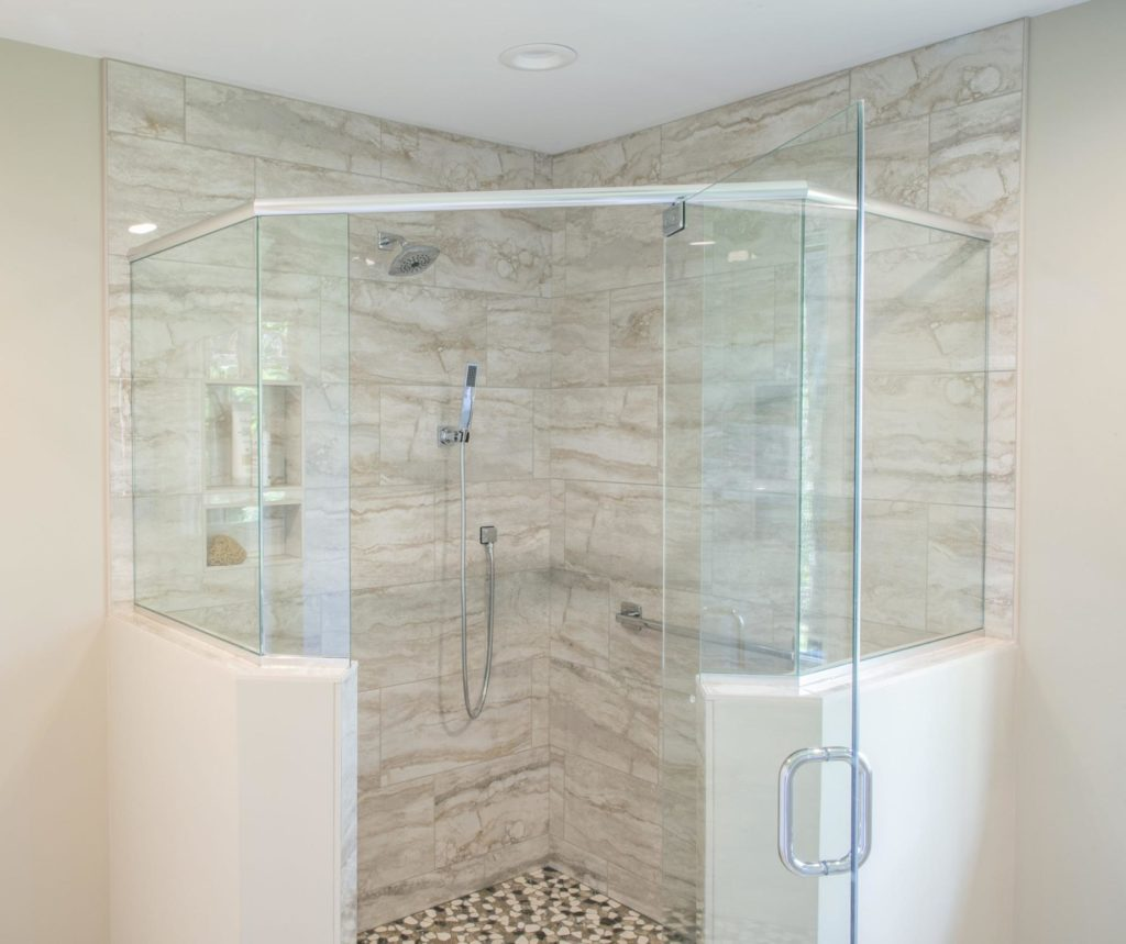 This beautiful shower mixes a variety of tile for texture and visual interest.
