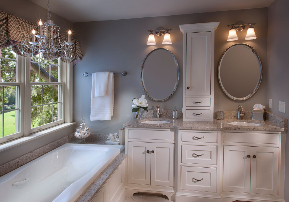 A bathroom remodeled with double vanities and a soaker tub.