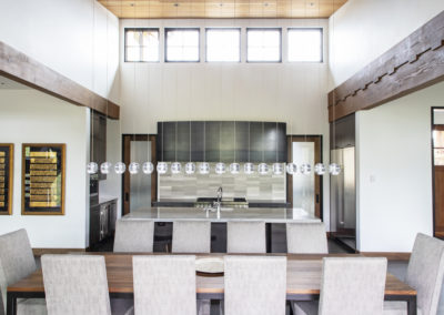 Remodeled kitchen with glass pendant lights and vaulted ceiling