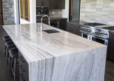 Quartz waterfall countertop kitchen island