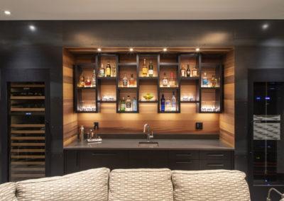 Backlit wet bar with custom bottle/glassware display shelves