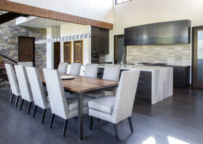 Remodeled kitchen and dining area with long dining table