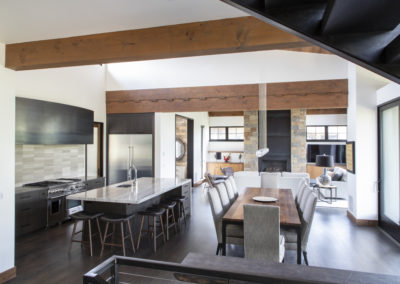 Remodeled kitchen and dining area with island and dining table