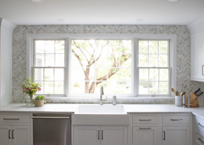 Remodeled kitchen sink area with large sunlit window