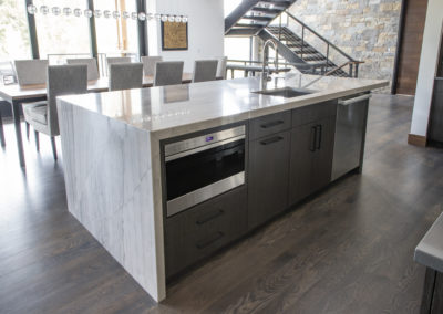 Renovated kitchen island with built in sink, microwave, and dishwasher