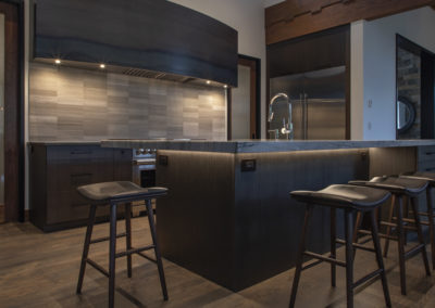 Renovated kitchen at night with soft lighting