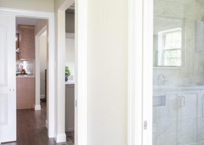 Hallway and bathroom doorway with glass wall shower