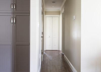 Remodeled hallway with hardwood floors