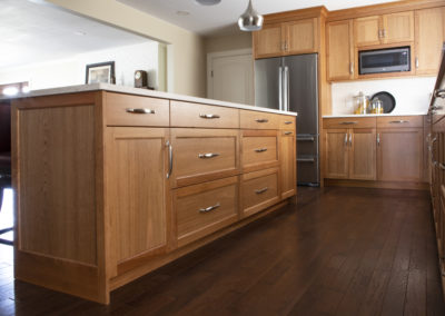 Remodeled kitchen island with brown cabinets