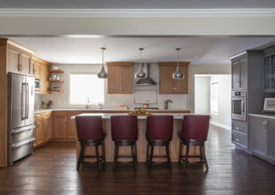 Remodeled kitchen with four chairs at a large island
