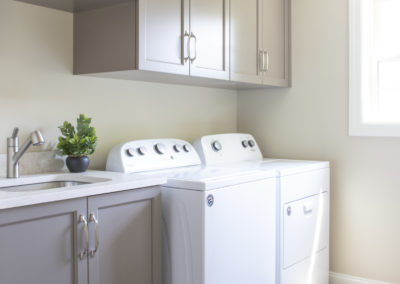 Remodeled laundry area with washer, dryer, and sink