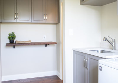 Remodeled laundry room with sink