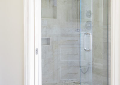 New walk in shower with glass doors