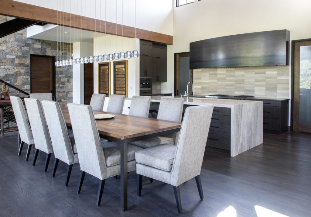 This modern kitchen and dining room have a variety of innovative textures and a simple color palette.