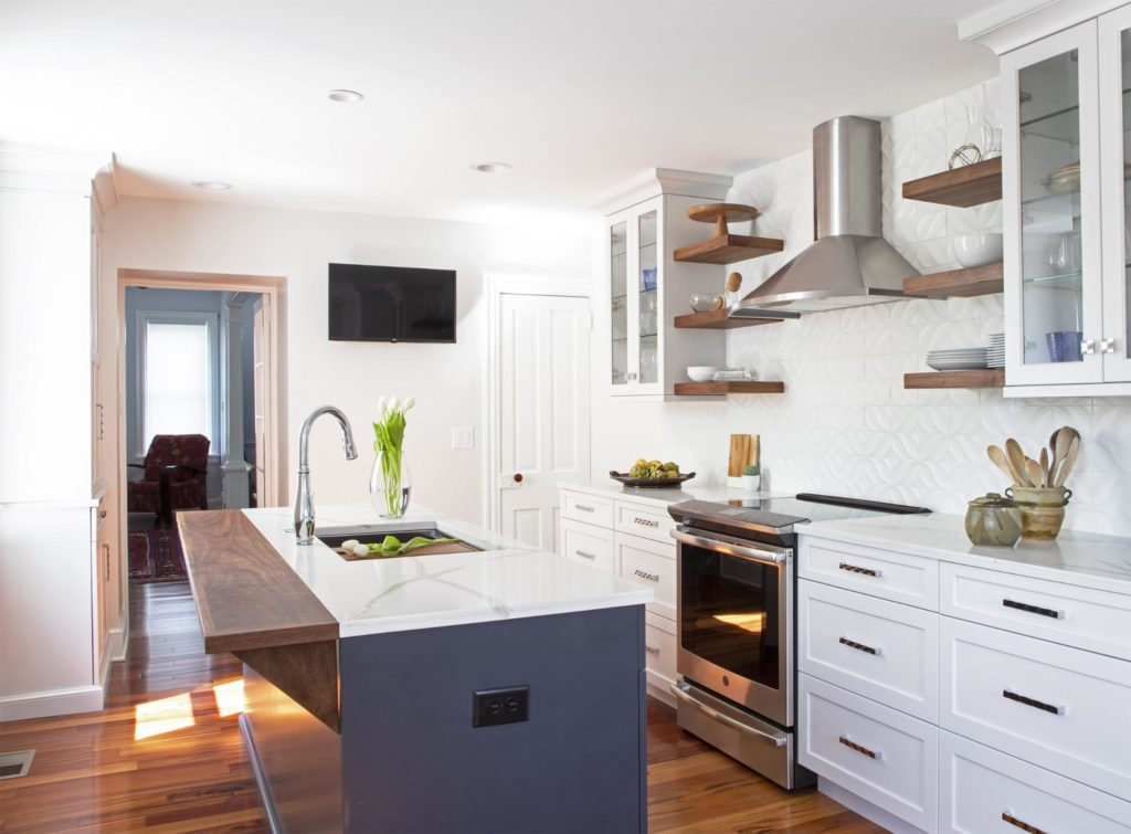 White cabinets with a dark island make this kitchen feel spacious yet cozy.