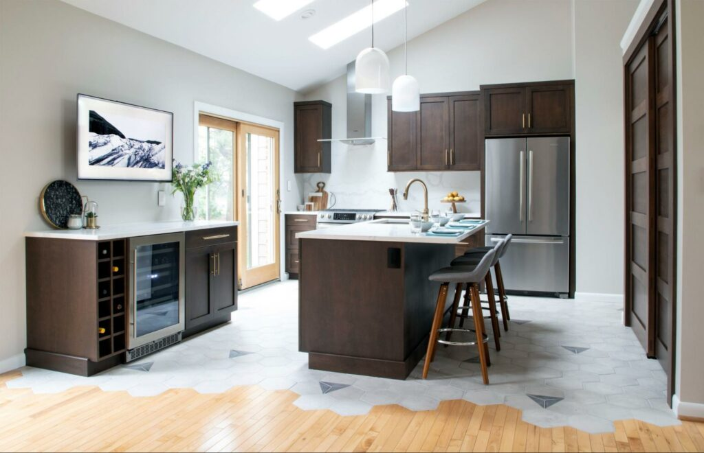 A kitchen with gorgeous wood cabinets with a dark stain.
