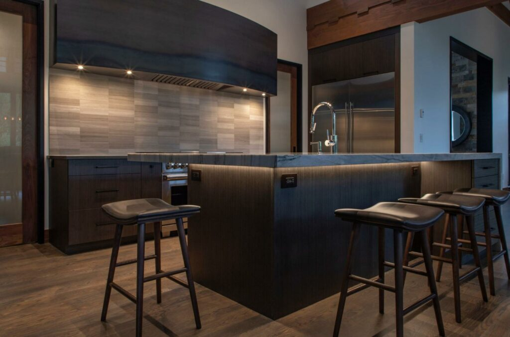 These upper kitchen cabinets have lighting underneath to illuminate the counter below at night.