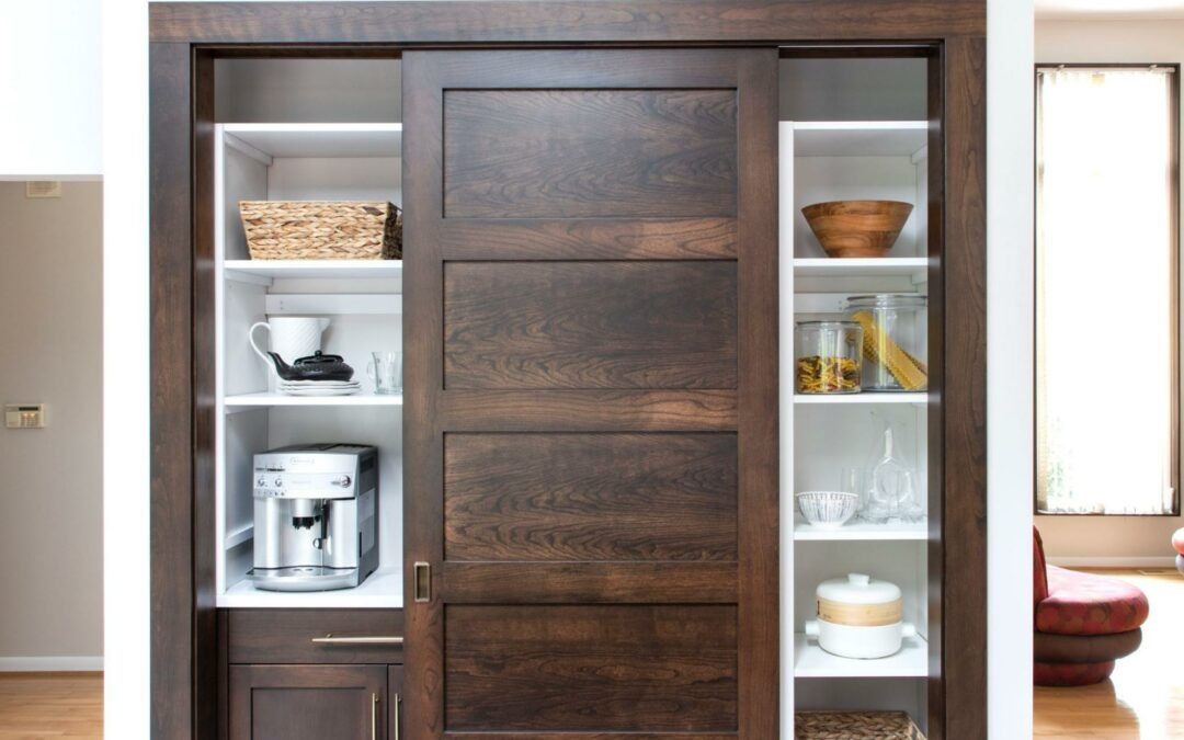 This beautiful wooden pantry is organized so that everything has a place.